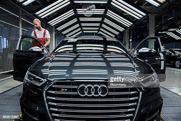 An employee performs a quality control check on the interior of an Audi S3 automobile inside the Audi AG production plant in Gyor Hungary on Monday...