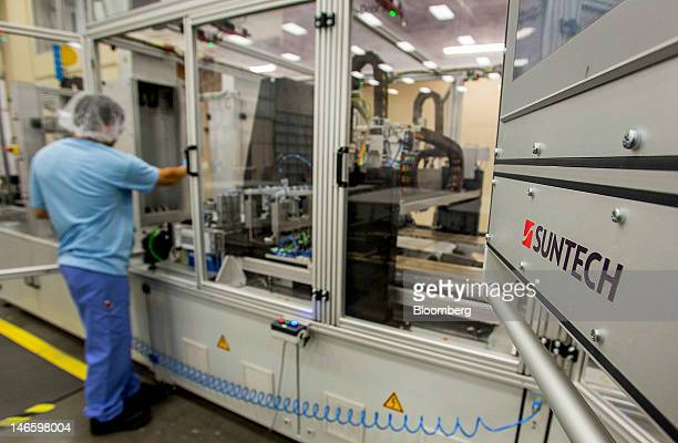 An employee performs a regular cleaning on the production line at the Suntech Power Holdings Co Ltd facility in Goodyear Arizona US on Monday June 18...