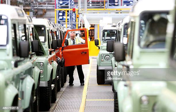 An employee performs final quality control checks on a Land Rover Defender automobiles at Tata Motors Ltd's Jaguar Land Rover vehicle manufacturing...