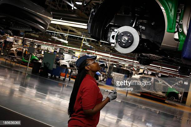 An employee performs quality control inspections on Sonata and Elantra vehicles at the Hyundai Motor Manufacturing Alabama assembly plant in...