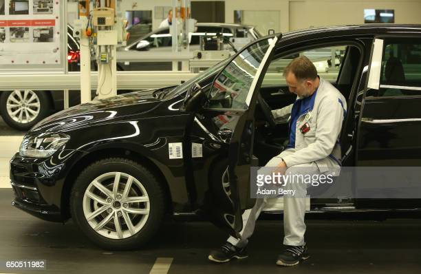 An employee performs the final inspection of a Golf 7 automobile at the Volkswagen factory on March 9 2017 in Wolfsburg Germany The company whose...