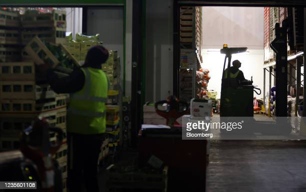 An employee picks a pallet of vegetables from racking at New Covent Garden Market wholesale market in London, U.K., on Wednesday, Sept. 29, 2021. As...