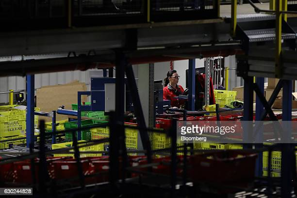 An employee picks an order at the Ocado Group Plc distribution centre in Dordon UK on Friday Dec 16 2016 Ocado provides home delivery of a wide range...