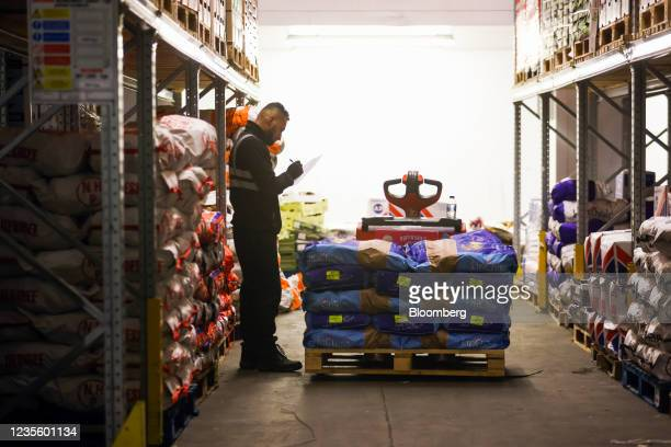 An employee picks an order of fresh vegetables at New Covent Garden Market wholesale market in London, U.K., on Wednesday, Sept. 29, 2021. As...