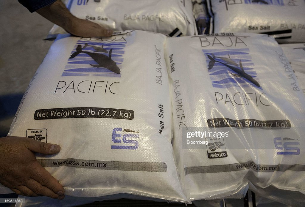An employee piles bags of Baja Pacific salt during the packaging process at the Exportadora de Sal (ESSA) plant in Guerrero Negro, Mexico, on Wednesday, Jan. 24. 2013. Exportadora de Sal (ESSA), a joint venture between Fidecomiso Mining Development Corporation and Mitsubishi, is one of the leading producers and suppliers of salt for the chlorine-alkali industry in the Pacific Rim. Photographer: Susana Gonzalez/Bloomberg via Getty Images