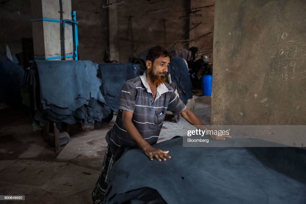 An employee piles hides at the Sheong Shi Tannery in Kolkata, West Bengal, India on Tuesday, Dec. 26, 2017. India's manufacturing sector grew in December as the Nikkei India Manufacturing Purchasing Managers' Index (PMI) rose to 54.7 from 52.6 in November, with a number above 50 indicating expansion. Photographer: Taylor Weidman/Bloomberg via Getty Images
