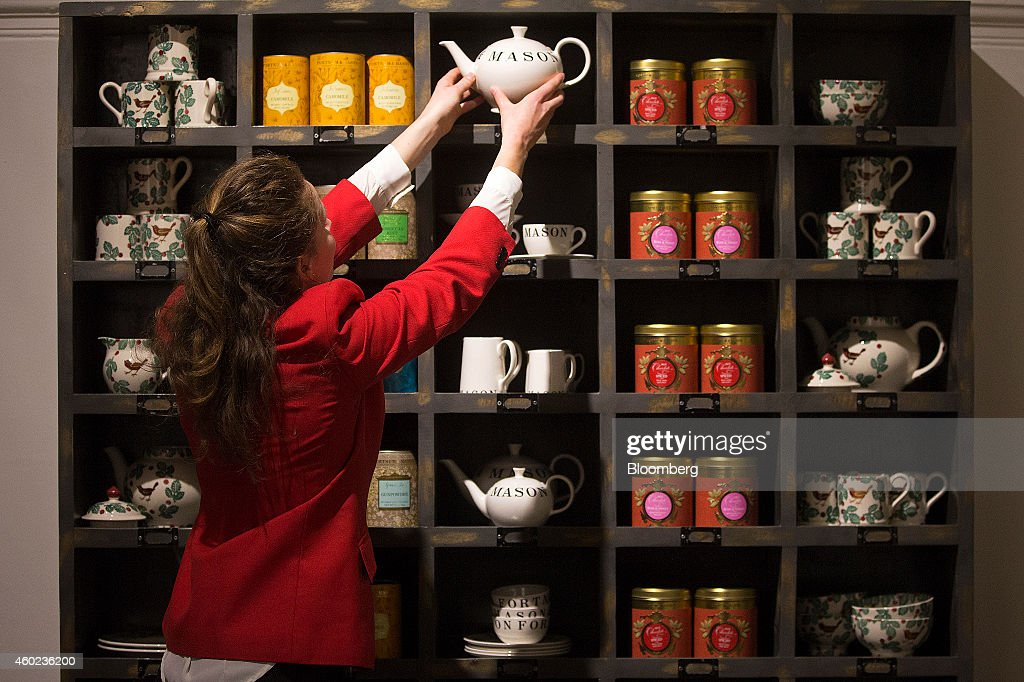 An employee places a teapot onto a specialty tea display shelf inside a pop-up store, operated by Fortnum & Mason Plc, during a seasonal Christmas event at Somerset House in London, U.K., on Tuesday, Dec. 9, 2014. The British will be the biggest spenders in Europe on Christmas gifts this year, according to a study commissioned by Dutch bank ING Groep NV. Photographer: Simon Dawson/Bloomberg via Getty Images