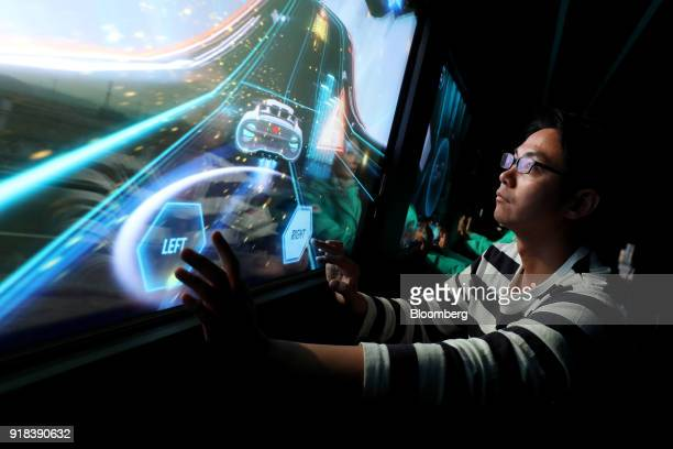 An employee plays a video game onboard an autonomous 5G connected bus operated by KT Corp as it travels along a road during a media event in...