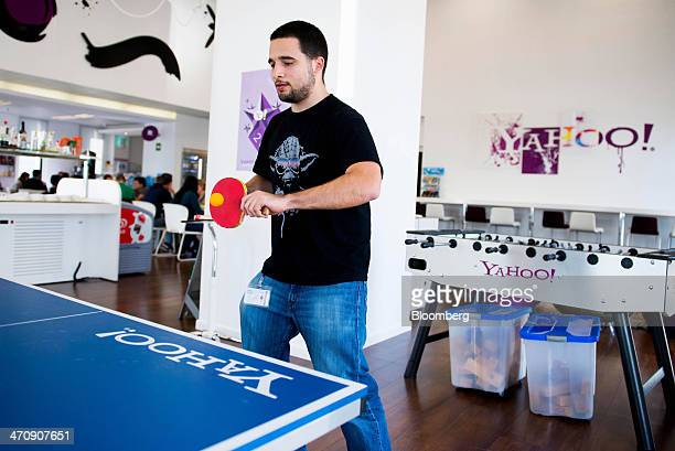 An employee plays table tennis in the cafeteria of the sales office at the Yahoo Inc headquarters in Barcelona Spain on Thursday Feb 20 2014 A smart...