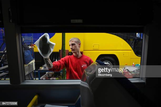An employee polishes the window of a completed Enviro 400 London bus at the Alexander Dennis Ltd factory in Scarborough UK on Wednesday Sept 13 2017...