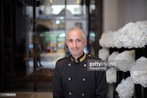 An employee poses during the inauguration of the Mandarin Oriental hotel in Paris on June 28, 2011. Mandarin Oriental group is a Hong-Kong based...