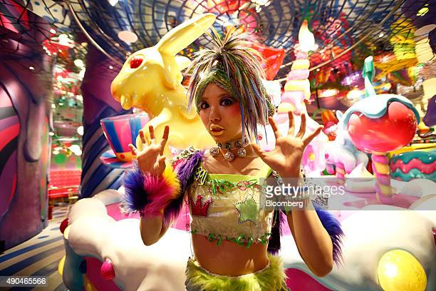 An employee poses for a photograph at the Kawaii Monster Cafe operated by Diamond Dining Co in the Harajuku area of Tokyo Japan on Thursday Sept 24...