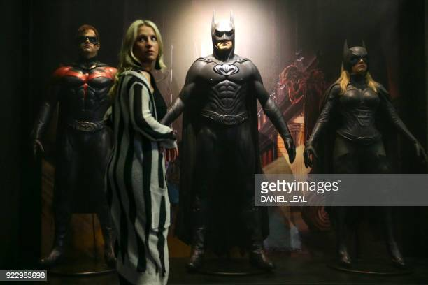 An employee poses in front of a Robin costume worn by actor Chris O'Donnell in 'Batman and Robin' 1997 and designed by Bob Ringwood and Robert...