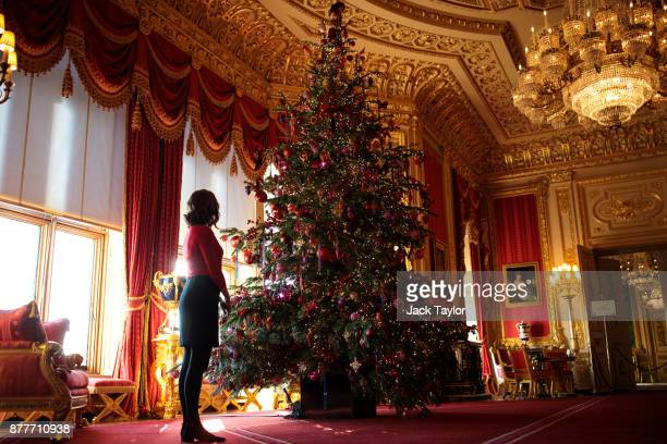 An employee poses with a 15ft Christmas tree in the Crimson Drawing Room which has been decorated for the Christmas period on November 23 2017 in...
