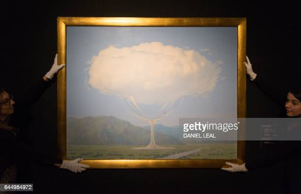 An employee poses with an artwork by Belgian artist René Magritte entitled La corde sensible with an estimated price of 14 million 18 million GBP...