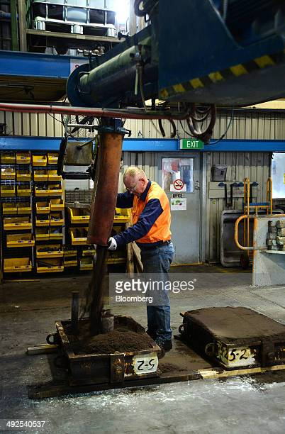 An employee pours a sand composite into a mold in the foundry at the Backwell IXL plant in Geelong Australia on Tuesday May 20 2014 Australia's real...