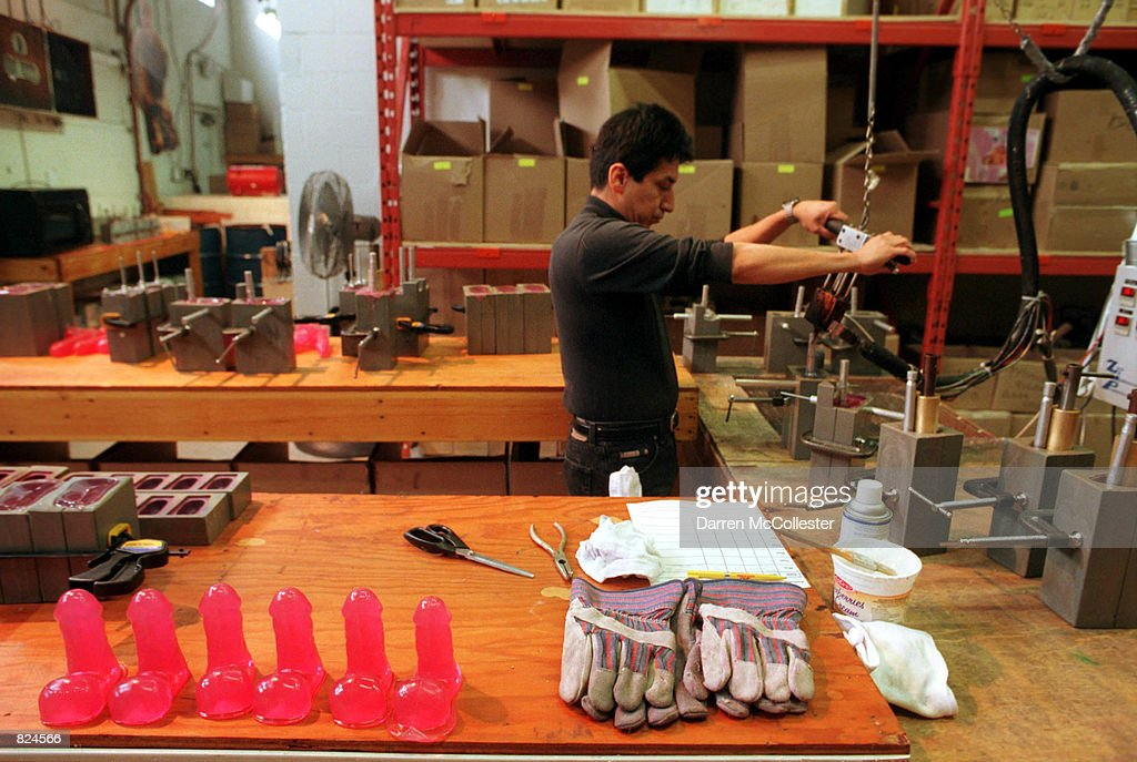 An employee pours polyvinylchloride into handmade molds February 20