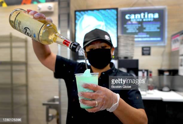 An employee pours tequila into the popular Mountain Dew Baja Blast frozen drink at the new Taco Bell Cantina in Brookline, MA on Dec. 4, 2020. The...