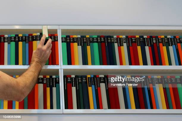 An employee prepare books at an exhibitor's stand prior to the opening of the Frankfurt Book Fair on October 9, 2018 in Frankfurt, Germany....