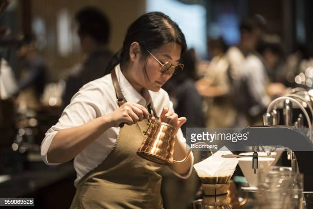 An employee prepares a beverage inside the Starbucks Corp Reserve Roastery store in Shanghai China on Friday May 11 2018 Starbucksis laying out an...