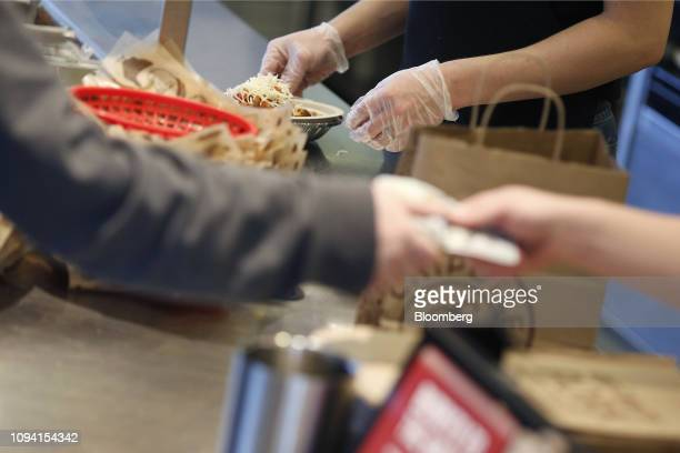 An employee prepares a burrito bowl at a Chipotle Mexican Grill Inc restaurant in Louisville Kentucky US on Saturday Feb 2 2019 Chipotle Mexican...