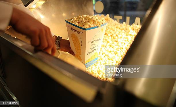 An employee prepares a carton of popcorn at an Odeon cinema on Leicester Square in London UK on Friday June 17 2011 BC Partners Ltd and Omers Private...