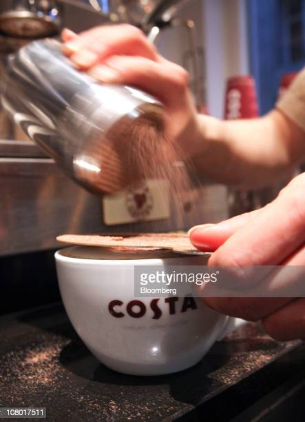 An employee prepares a cup of cappuccino coffee at a 'Metropolitan' Costa Coffee shop in London UK on Wednesday Jan 12 2011 Whitbread Plc may be...