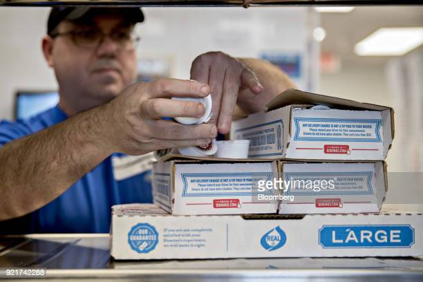 An employee prepares a customer's delivery order at a Domino's Pizza Inc restaurant in Chantilly Virginia US on Tuesday Feb 20 2018 Domino's released...