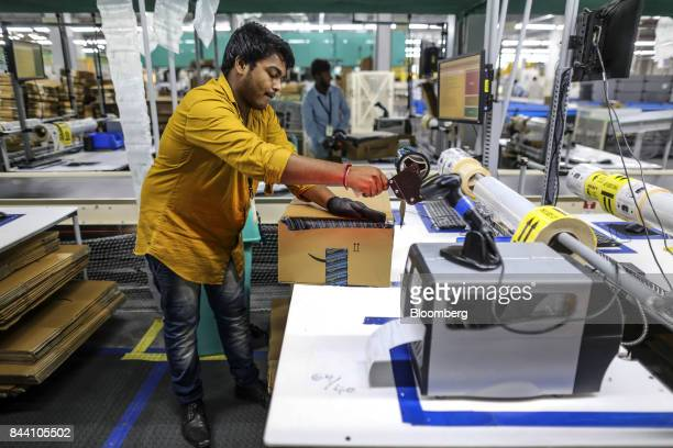 An employee prepares a package for shipment at the Amazoncom Inc fulfillment center in Hyderabad India on Thursday Sept 7 2017 Amazon opened its...