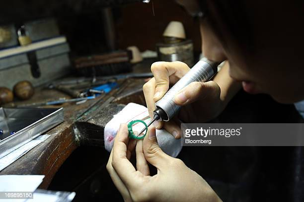 An employee prepares a wax mold for a ring design at the Myanmar VES Joint Venture Co gems and jewelry workshop in Yangon Myanmar on Monday June 3...
