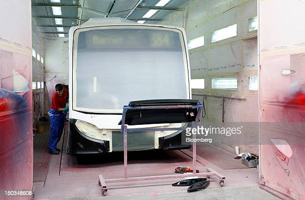 An employee prepares an Enviro 200 bus in the spray painting booth at Paxton Ltd's plant part of the Alexander Dennis Ltd group in Scarborough UK on...
