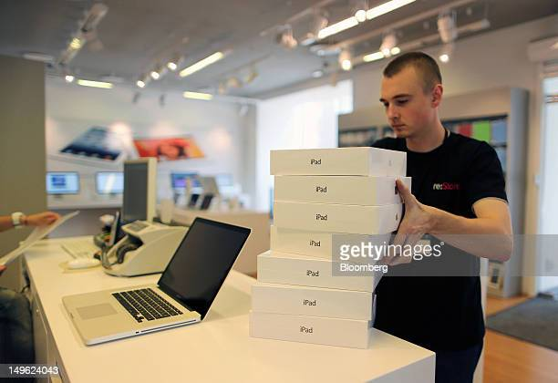 An employee prepares boxes of Apple Inc iPad tablet computers for sale at a reStore a premium Apple product reseller in Moscow Russia on Wednesday...