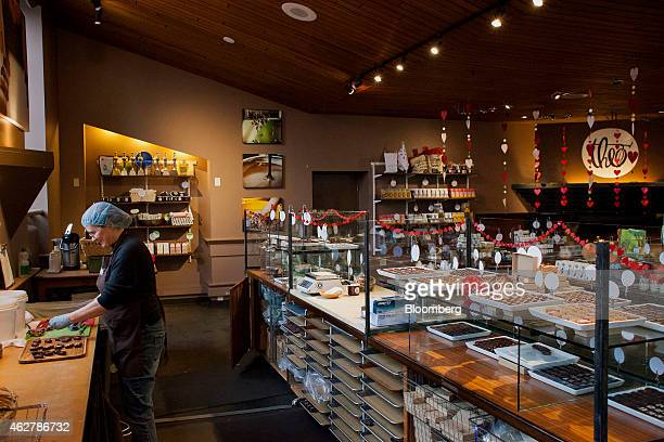 An employee prepares chocolate samples in the retail space at the Theo Chocolate factory in Seattle Washington US on Monday Feb 2 2015 The US Census...