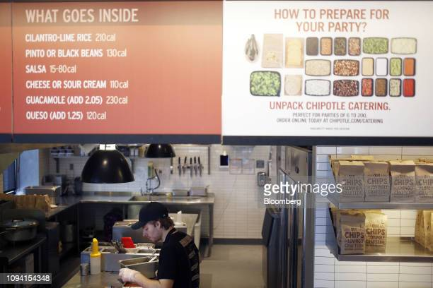 An employee prepares food in the kitchen at a Chipotle Mexican Grill Inc restaurant in Louisville Kentucky US on Saturday Feb 2 2019 Chipotle Mexican...