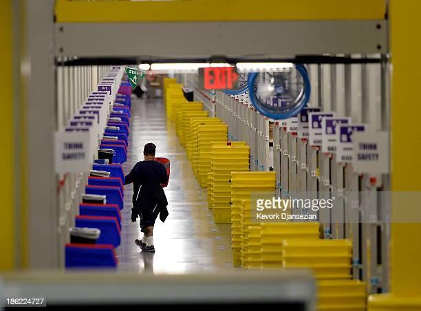 An employee prepares order at Amazon's San Bernardino Fulfillment Center October 29, 2013 in San Bernardino, California. Amazon's 1...