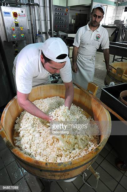 An employee prepares shredded curd before it is turned into mozzarella di bufala or buffalo mozzarella at the Baronia factory near Caserta north of...