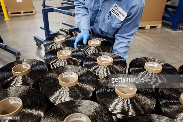 An employee prepares spools of carbon fiber for shipment at the SGL Automotive Carbon Fibers manufacturing plant in Moses Lake Washington US on...
