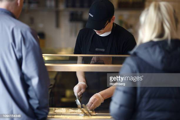 An employee prepares tacos for customers at a Chipotle Mexican Grill Inc restaurant in Louisville Kentucky US on Saturday Feb 2 2019 Chipotle Mexican...