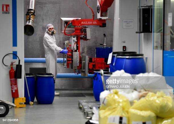 An employee prepares the ingredients of a pharmaceutical composition at the plant of French multinational pharmaceutical company 'Pierre Fabre' in...