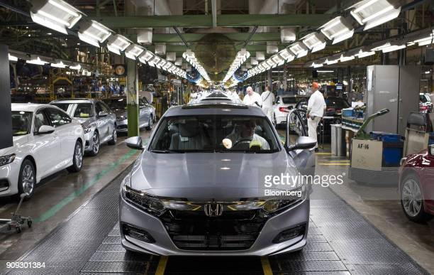 An employee prepares to drive a 2018 Honda Accord vehicle off the assembly line at the Honda of America Manufacturing Inc Marysville Auto Plant in...