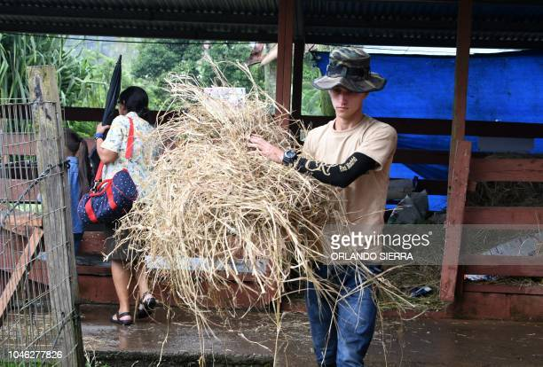 An employee prepares to feed animals at the Joya Grande zoo and ecopark in Santa Cruz de Yojoa Cortes department 160 km north of Tegucigalpa Honduras...