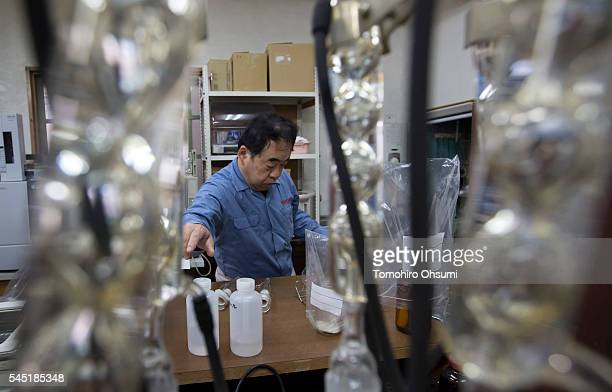 An employee prepares to inspect mosquito coils in a laboratory at the Kishu Factory of Dainihon Jochugiku Co Ltd on July 6 2016 in Arita Japan...