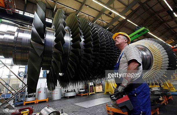 An employee prepares to lift the rotor coil of a Siemens AG Gas Turbine class H is seen at the German industrial giant Siemens historic construction...