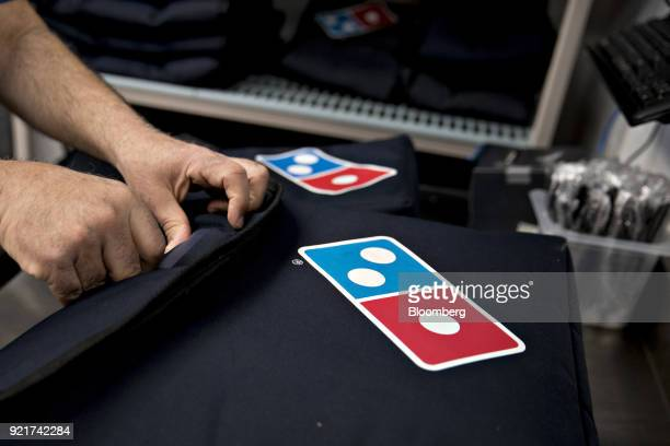 An employee prepares to make a delivery at a Domino's Pizza Inc restaurant in Chantilly Virginia US on Tuesday Feb 20 2018 Domino's released earnings...