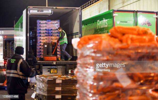 An employee prepares to remove a pallet of fresh vegetables from the back of a truck at New Covent Garden Market wholesale market in London, U.K., on...