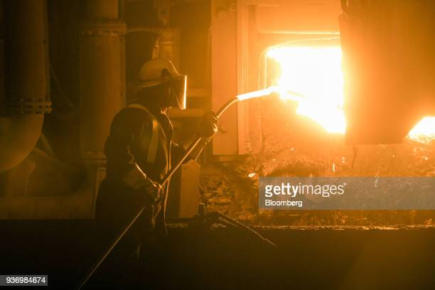 An employee prepares to take a sample from the electric arc furnace at Liberty Steel's Aldewerke mill in Rotherham UK on Wednesday March 21 2018 Most...