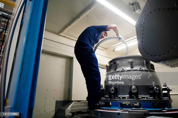 An employee prepares to work on an aircraft engine at the Volvo Aero factory a division of Volvo AB in Trollhaettan Sweden on Monday March 12 2012...
