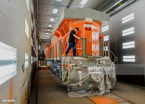 An employee preps a diesel locomotive for painting at the General Electric Manufacturing Solutions facility in Fort Worth Texas US on Tuesday Sept 2...
