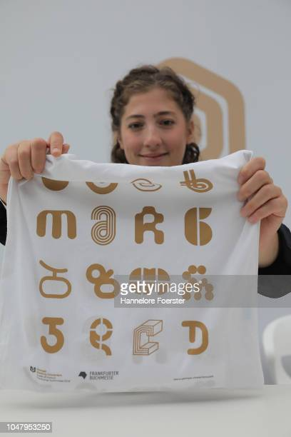 An employee presents a bag with letters of Georgia, the Guest of Honour, at the Frankfurt Book Fair on October 9, 2018 in Frankfurt, Germany....