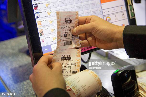 An employee prints out a customer's tickets at the first public screening of Walt Disney Co's Star Wars The Force Awakens at a Vue Entertainment Ltd...